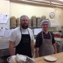 Seminarian Joseph Birthisel and Subdeacon Nicholas Mihaly working in the Mission bakery.