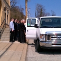 Fr Jonathan Tobias blesses the van transporting the students for a safe journey prior to leaving for St John the Compassionate Mission